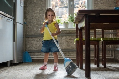 little girl doing her cleaning chores
